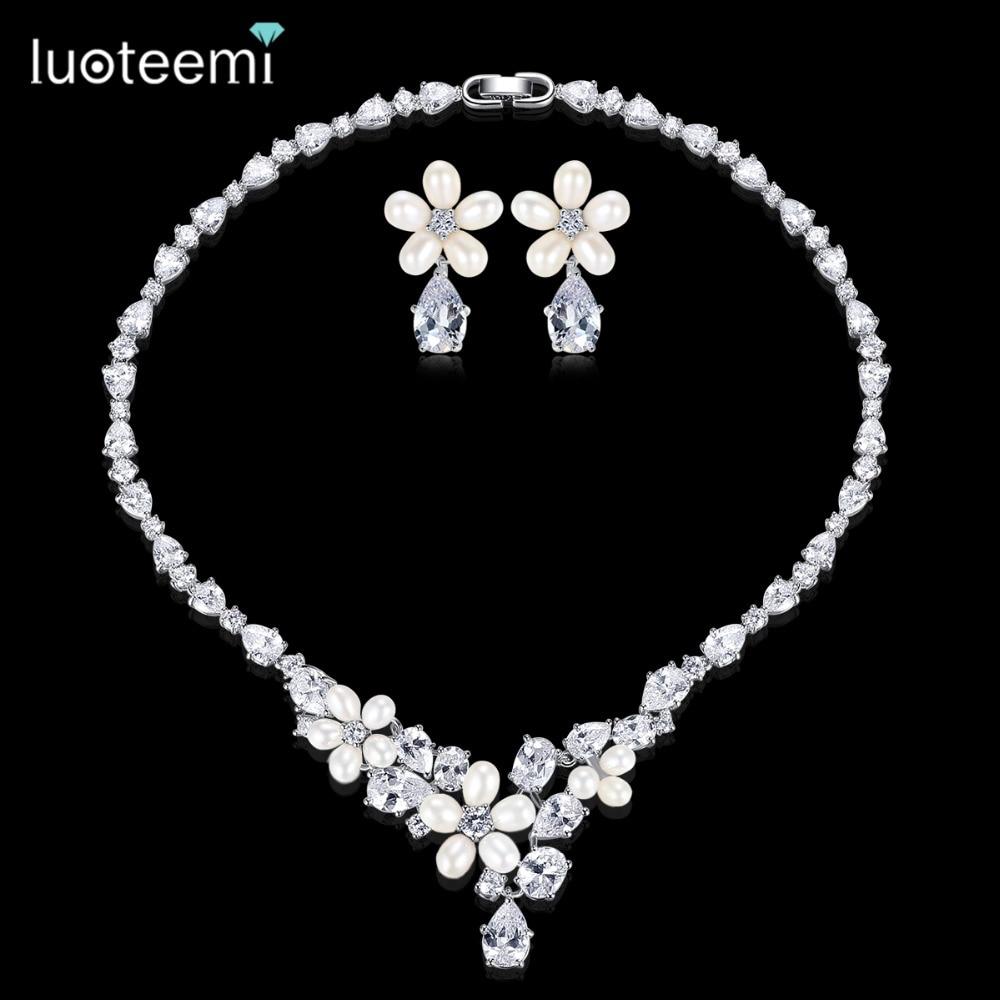 купить LUOTEEMI Generous Rhinestone Flower Earrings Necklace Natural Pearls with Teardrop CZ Wedding Jewelry Sets For Bride Accessories по цене 1953.57 рублей
