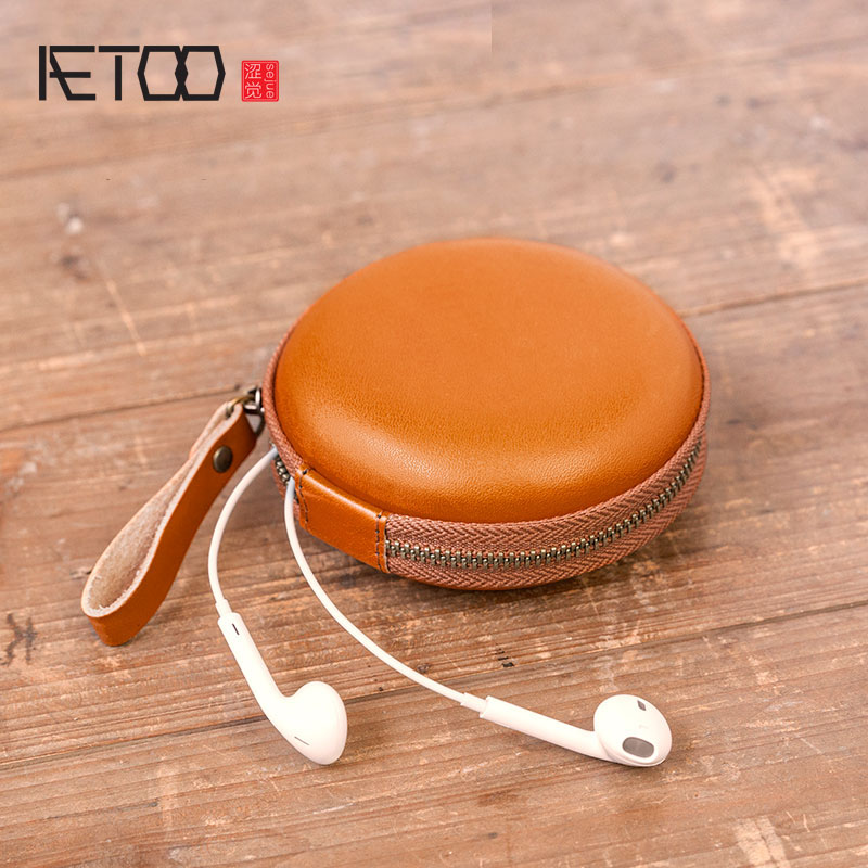 AETOO Mobile phone charger headset pack zero wallet, first layer leather condom storage box multi-function.