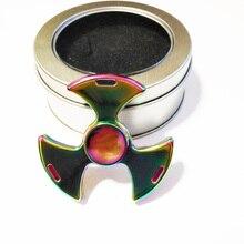 Newstyleที่มีสีสันมืออาชีพEDCมือปั่นของเล่นMeatelอยู่ไม่สุขtri-s Pinnerสำหรับผู้ใหญ่และเด็กของขวัญ
