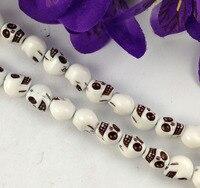 6 Strands of 40 pcs white skull acrylic beads #22634
