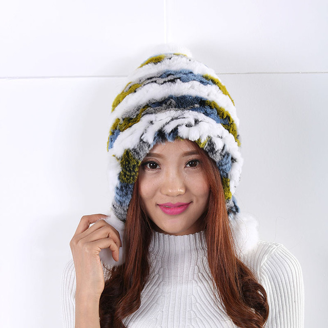 The fall and winter Rex wool ball wool cap sleeve head cap warm fashion casual style wild fashion cute earmuffs thickening Hat