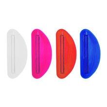 Dropshipping todos os novos 1 pçs acessórios do banheiro tubo de plástico pasta de dentes squeezer dispenser titular titular do banheiro rolamento extrato