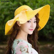 Primavera de 2015 Venta al por mayor y venta al por menor de las mujeres de  la moda de ala grande disquete verano playa sombrero. c94e6b389df