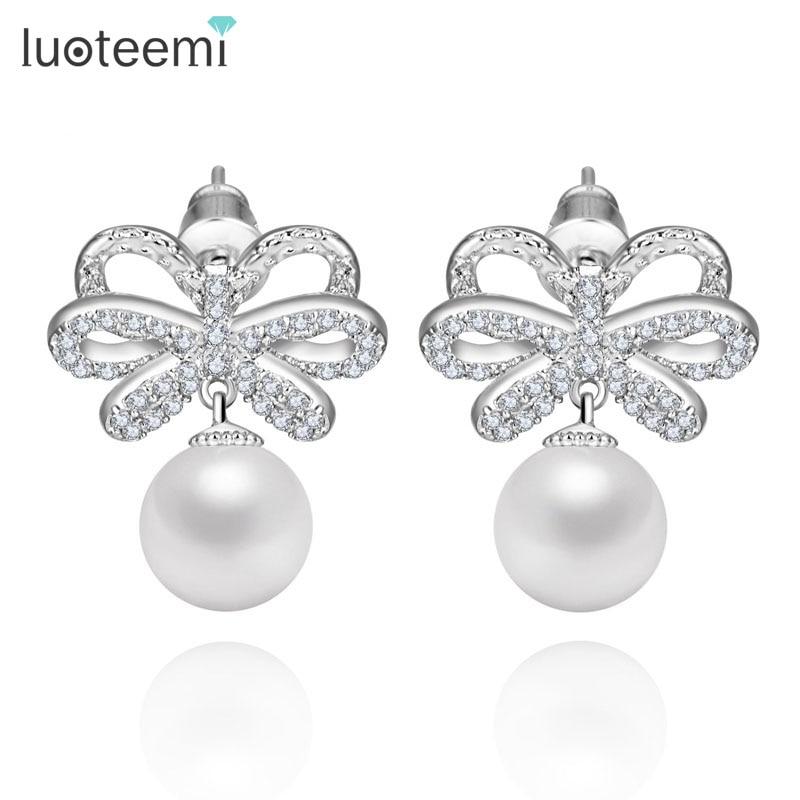 a2062f3bcaff LUOTEEMI marca de lujo perla simulada pendientes para las mujeres de la  Zirconia cúbica clara Bowknot aretes de oro blanco Color de la joyería de  las ...