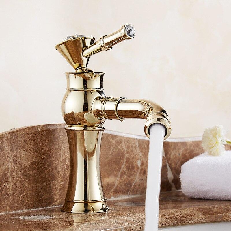 купить Golden faucet 360 degree rotating copper faucet mouth rotating hot and cold basin faucet bathroom tools по цене 2802.62 рублей
