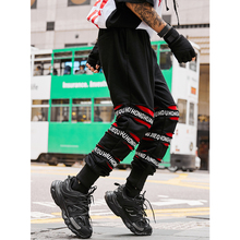 купить UNCLEDONJM Ripped tapered pants 2019 men joggers pants street style hip hop sweatpants 2019 new arrival brand leisure pants 071W по цене 1866.66 рублей