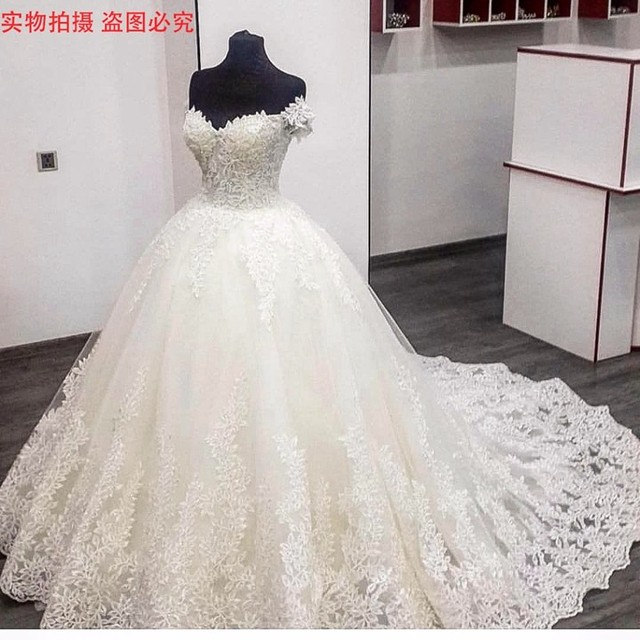 Gorgeous Puffy Ball Gown White Wedding Dresses 2017 Beaded Lace Top ...