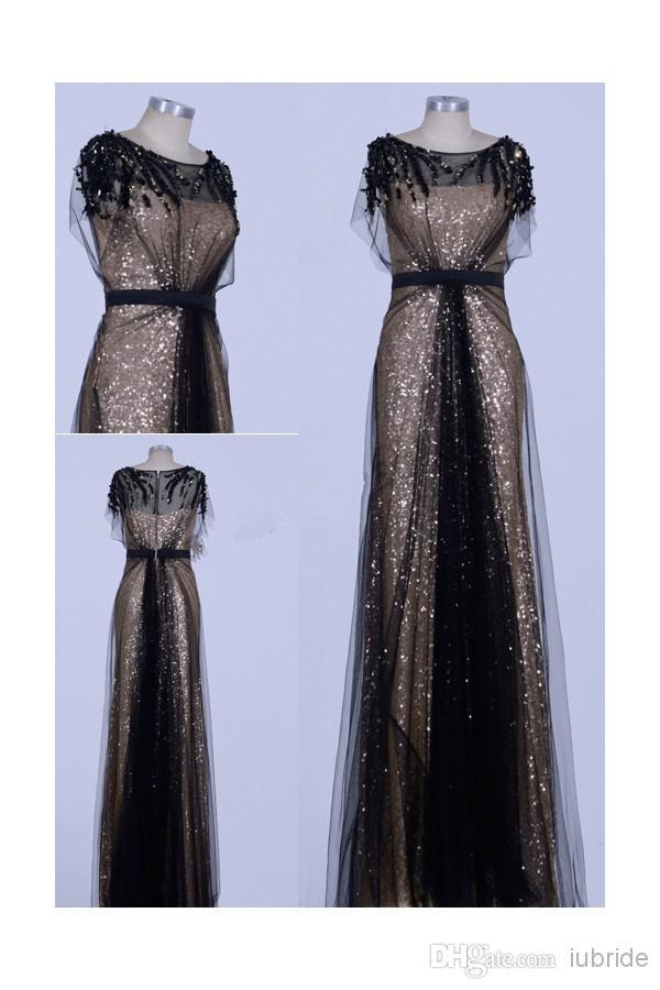 2015 Cheer Evening Gowns Gold Round Neck Short Sleeves Empire Waist Sequins  Gold Sequins black Net Sweep Train Prom Dress-in Evening Dresses from  Weddings ... 724e24709fdb