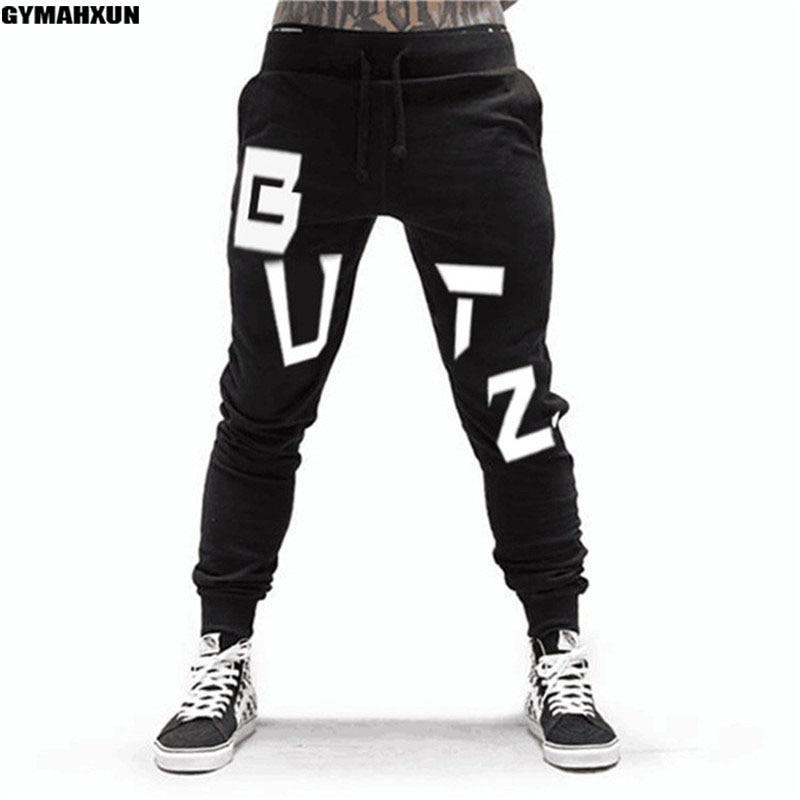 74f3772ef2 Academias de ginástica Corredores sweatpants Calças Dos Homens de fitness  Musculação roupas de Alta qualidade da