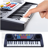2017 New Children 's electronic organ toys with microphone infants teaching baby instruments education music toys