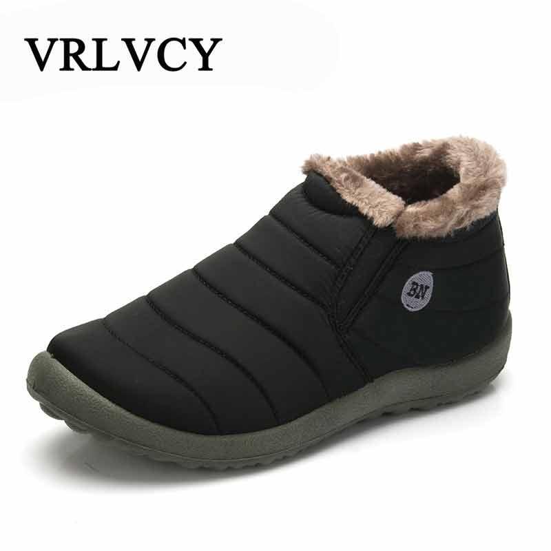 Nuevos zapatos de invierno de moda para hombre botas de nieve de Color sólido de felpa interior antideslizante inferior mantener calientes botas de esquí impermeables tamaño 35-48