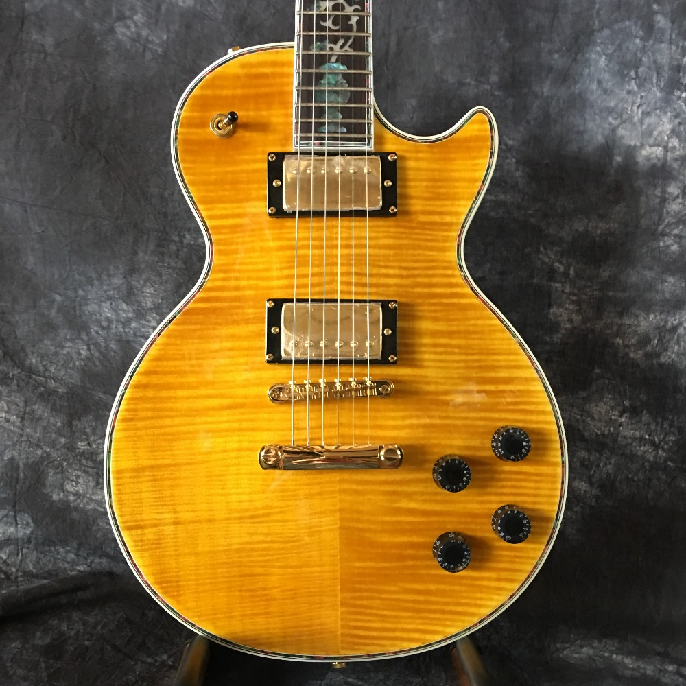 High quality, LP custom guitar, yellow and red, ebony inlaid, real photos, factory wholesale, can be modified.  free delivery high quality custom store electric guitar silver hardware ebony lp guitar wholesale and retail real photos