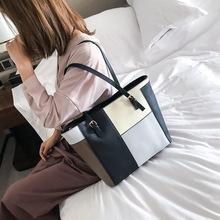 купить Female Fashion PU Leather Panelled Color Tote Fashion Designer Black Handbag for Women Big Capacity Casual Shoulder Shopper Bag по цене 1172.79 рублей