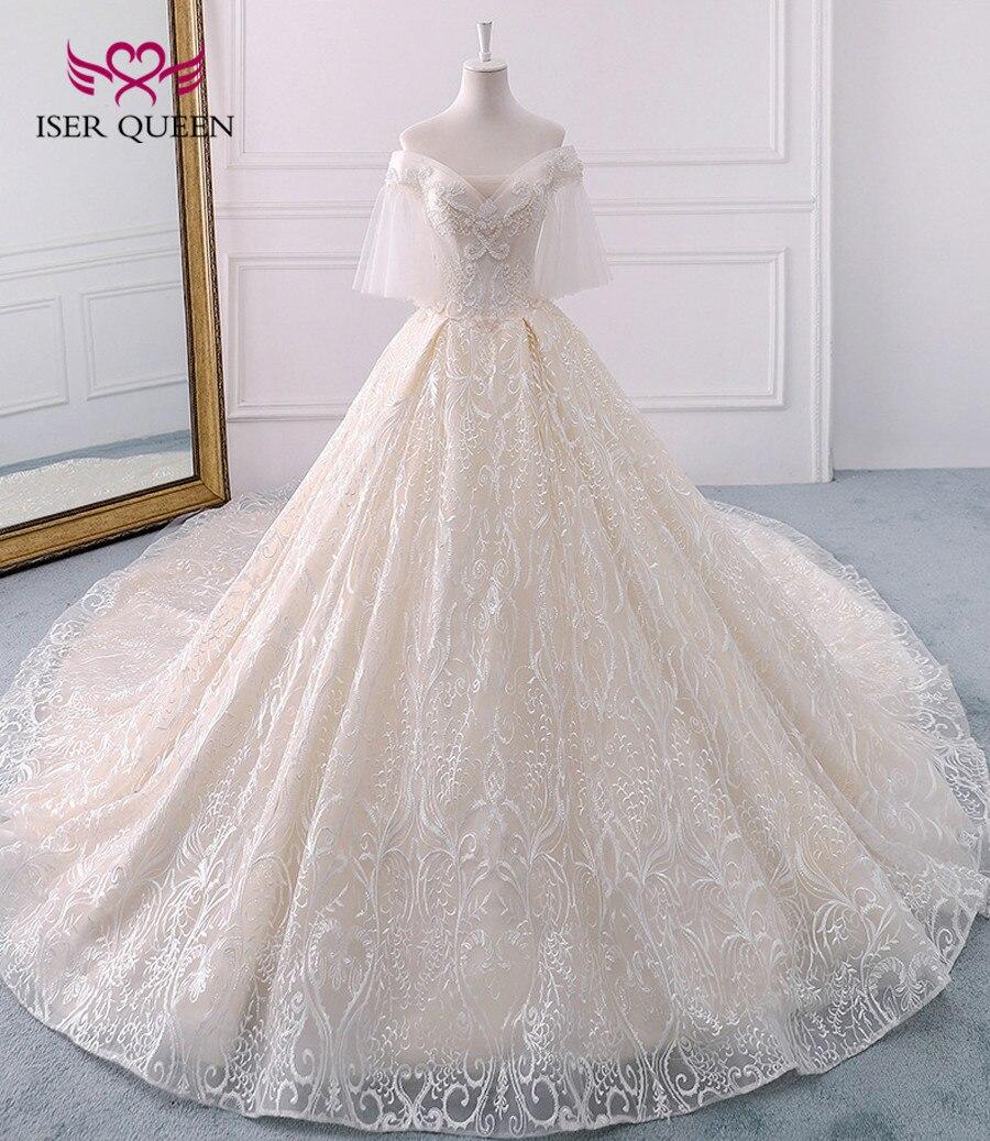 653 35 De Descuentotren Real Largo Blanco Vintage Encaje Vestido De Novia Manga Corta Perlas Vestido De Baile Vestidos De Novia 2019 Wx0121 In