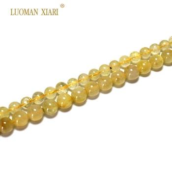 9b1573a612fd AAA + oro Natural Rutilated cuarzo cristal redondo piedra perlas para  joyería hacer DIY pulsera collar Strand 6 8mm 15