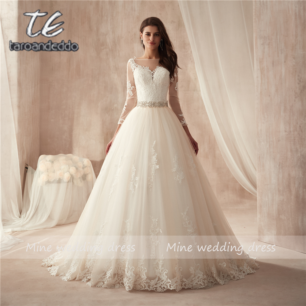 3152adb7e982 Sheer Crew Neck Sexy See Through Button Back Long Sleeves Appliques Vintage  Lace Wedding Dresses ...
