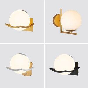 Image 1 - Moderne Glas Wand Lampe Mond Gold Schwarz Weiß Design Runde Indoor Nacht Lesen Lampe Montiert Nordic Holz Führte Wand Licht leuchte