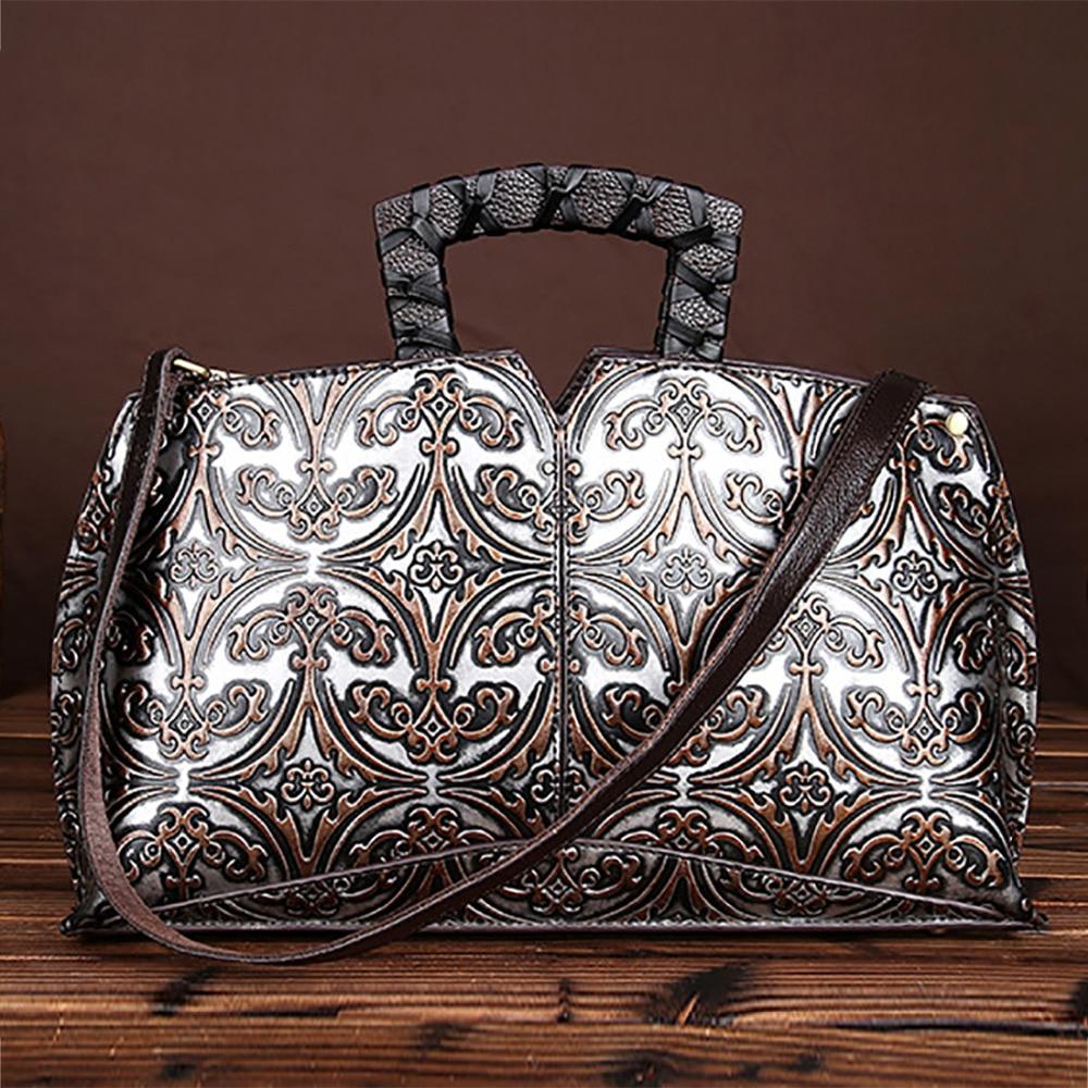 ヴィンテージトレンドの女性エンボス加工ハンドバッグ本革第一層牛革ハンドバッグ有名なブランドカジュアルメッセンジャーショルダーバッグ新  グループ上の スーツケース & バッグ からの トップハンドルバッグ の中 1