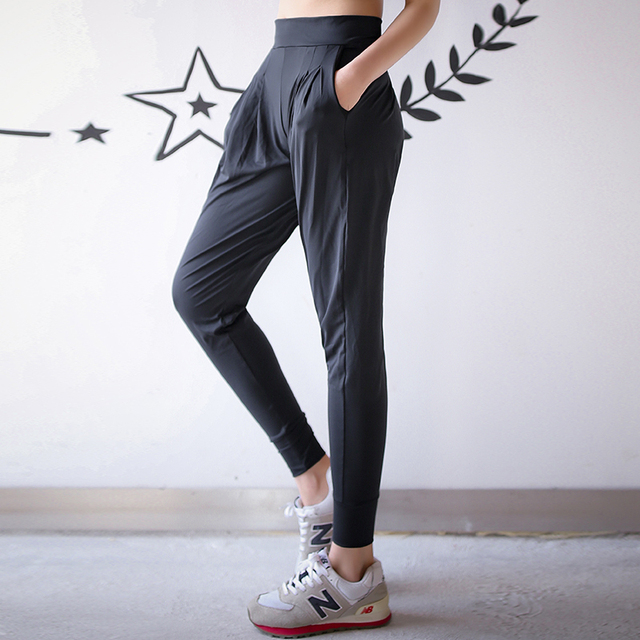 a7d4d49bd8493 High Quality Women Yoga Pants Leggings Pants Elastic Loose Sexy Yoga Capri  with Pocket for Workout Gym Jogging