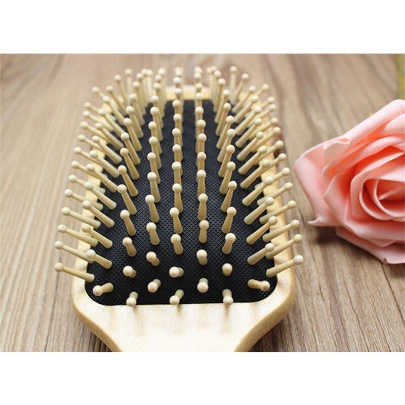 Купить с кэшбэком Wooden Comb Hair Care Wooden Spa Massage Comb Paddle Pointed Handle Teeth Hair Brush Antistatic Cushion Comb Tool P20