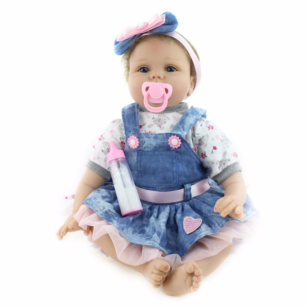 Фотография Cute 55cm Reborn Baby Doll Toys Soft Body Silicone Denim Dress For Girls NewBorn Bedtime Early Educational Dolls Toys Gift Hot