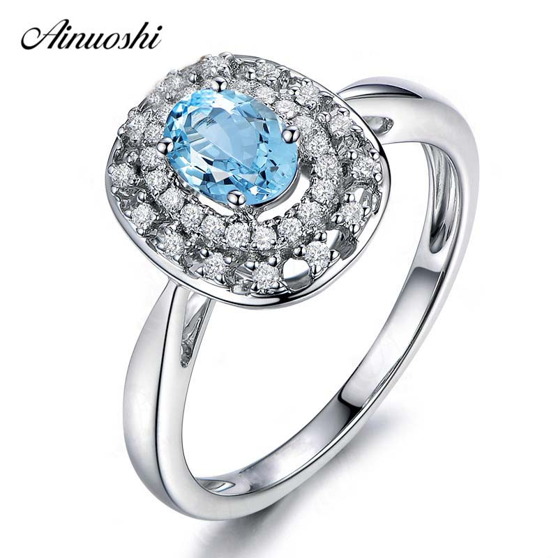AINUOSHI Genuine 925 Silver Natural Blue Topaz Halo Ring 0.5 Carat Oval Cut Double Halo Ring Trendy Wedding Engagement RingAINUOSHI Genuine 925 Silver Natural Blue Topaz Halo Ring 0.5 Carat Oval Cut Double Halo Ring Trendy Wedding Engagement Ring