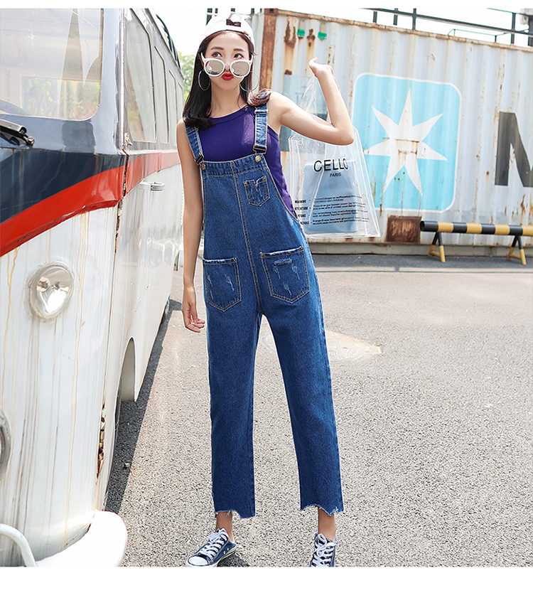 Stylish suspender jeans. College style, casual denim pants. (29)