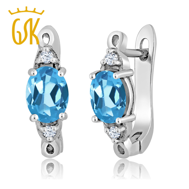 GemStoneKing 2.96 Ct Oval Natural  Blue Topaz White Created Sapphire 925 Silver Three Stone Earrings For Women