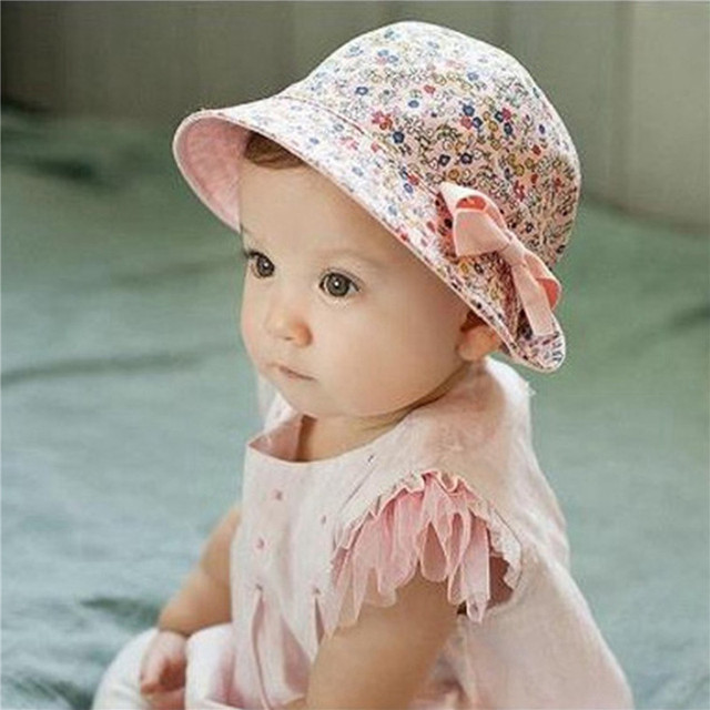 46f52f3fdc3f2 2018 Hot Flower Printed Cotton Baby Summer Hat Kids Girls Cute Bow Knot Cap Sun  Bucket Hats Fashion Double Sided Can Wear