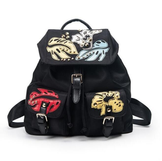 2018 new Chinese style woman fashion metal studded black nylon with colorful leaf print backpack buckle travelling bag