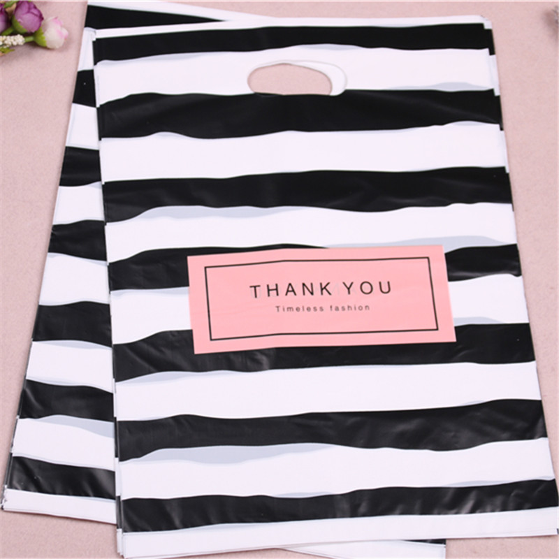 Image 2 - New Design Wholesale 100pcs/lot 25*35cm Luxury Fashion Shopping Plastic Gift Bags with Thank You Favor Birthday Packaging-in Gift Bags & Wrapping Supplies from Home & Garden