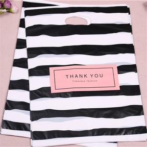 Image 2 - Nouveau Design en gros 100 pcs/lot 25*35cm luxe mode Shopping en plastique cadeau sacs avec merci faveur anniversaire emballage
