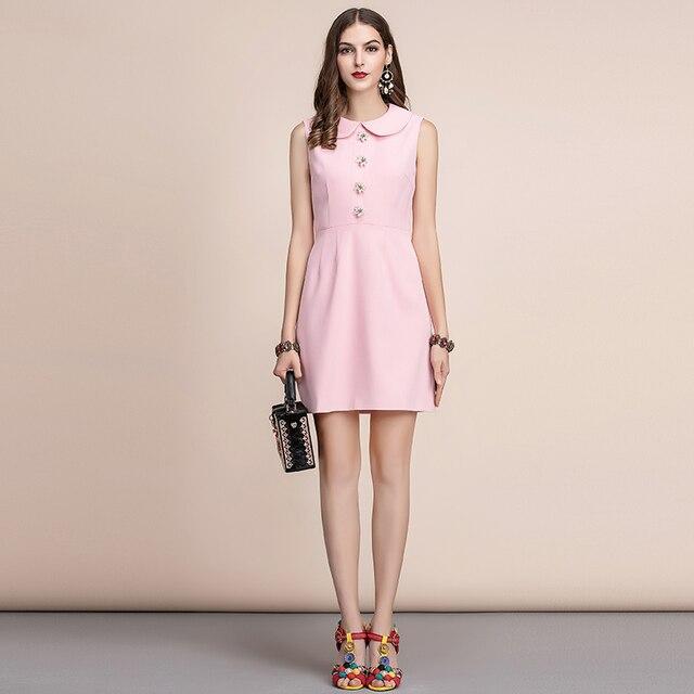 Vestido verano rosa corto sin mangas botón flor