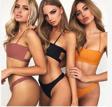 купить 2019 Women High Cut Bikinis Bandeau Back Cut Out Bikini Set Halter Padded Solid Color Beachwear Bathing Suit Beach Swimwear по цене 577.47 рублей