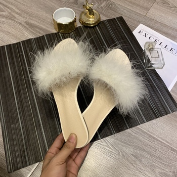 Hairy female Wearing a word belt 2019 summer new style Korean version of the wild red Flat fashion Lazy slippers Women's shoes