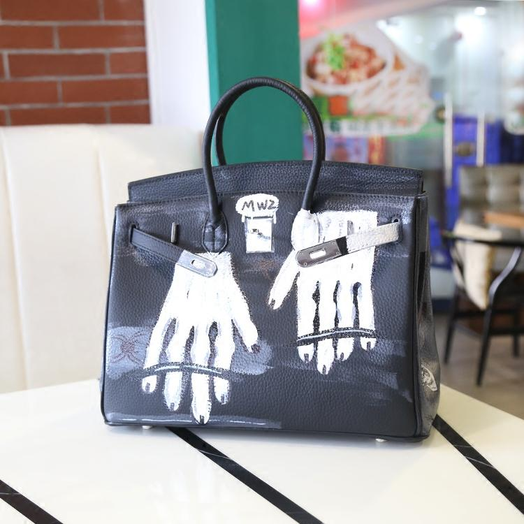 2016 new Leather handbags hand-drawing graffiti ghost hand bag hit color leather Platinum package large hand bag Graffiti bag