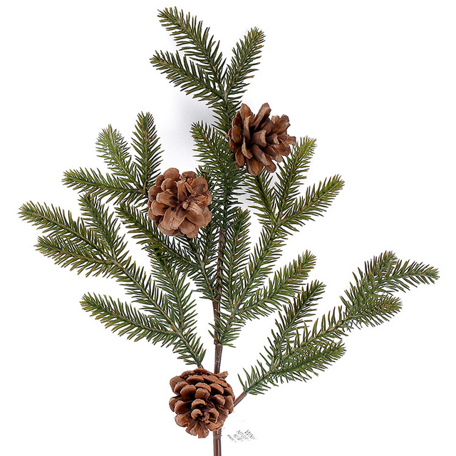 dried real pine nuts with artificial plastic pine tree branch pinaster leaves for christmas tree party