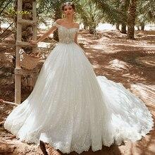 Loverxu ثوب حفلة على شكل قلب فستان زفاف متألق 2019 أنيق مزين على الكتف فستان عروس ذيل كاتدرائي فستان زفاف