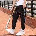2016 Pantalones de Carga hombres Pantalones casuales overoles más tamaño rayas de Color personaje de dibujos animados L-4XL Loose Harem Danza Hip Hop Pantalones