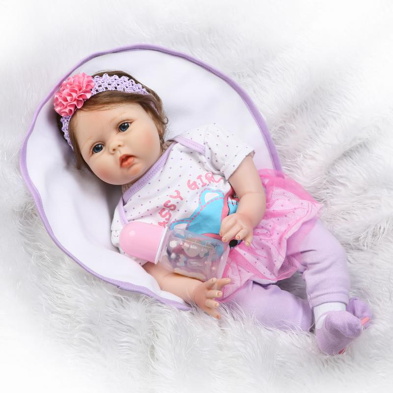 цены New Arrival Soft Silicone Reborn Baby 22 Inch Cloth Body Lifelike Baby Dolls With Fiber Hair Girl Bebe Alive Doll Xmas Gifts