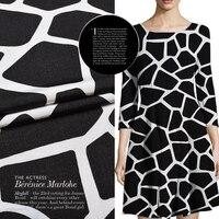 Hươu cao cổ màu đen vogue animal hạt nhập khẩu nặng trọng lượng thin fine dòng vải ma thuật designer bông vải