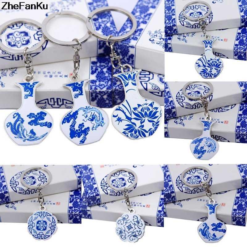 الإبداعية الصينية الأزرق والأبيض طبق مستدير من البورسلين زهرية هدية المفاتيح المعدنية مفتاح قلادة كيرينغ هدية تذكارية سياحية