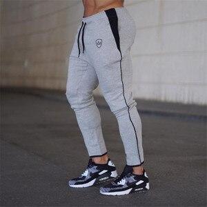 Image 3 - YEMEKE 2019 bawełna mężczyźni pełne spodnie sportowe Casual elastyczne męskie spodnie do ćwiczeń Fitness obcisłe spodnie dresowe spodnie do biegania