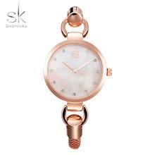 SK Nuevas mujeres de la moda relojes de pulsera elegante reloj de oro rosa de diamantes chica ahueca hacia fuera la correa de Acero Inoxidable reloj de Cuarzo 2017