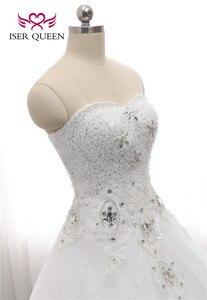 Image 4 - Kapalı omuz nakış dantel düğün elbisesi es güzel kristal boncuk topu cüppe şeklinde gelinlik düğün elbisesi moda kat uzunluk WX0006