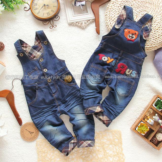 Retail 2015 nueva otoño niños overol de mezclilla pantalones para niños baby boy pantalones casuales de la niña babero del dril de algodón