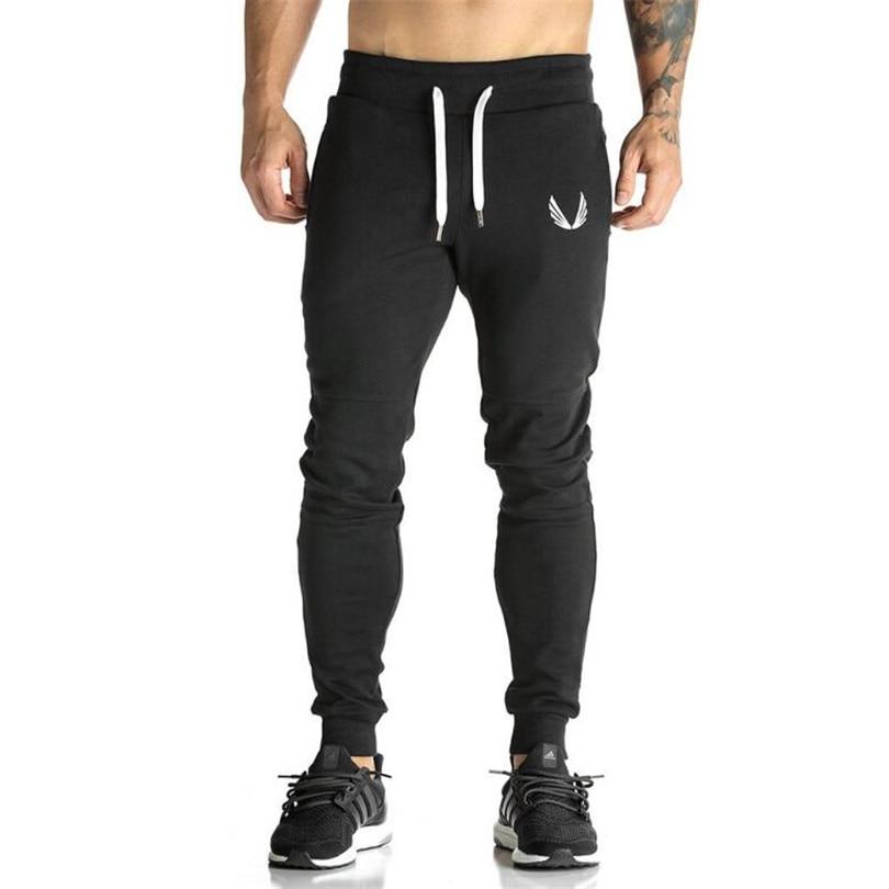 2017 Degli Uomini Del Cotone Jogger Sportswear Pantaloni Casual Elastico Di Cotone Mens Allenamento Fitness Pantaloni Skinny Pantaloni Sportivi Pantaloni Jogger Pantaloni Pantaloni Senza Ritorno