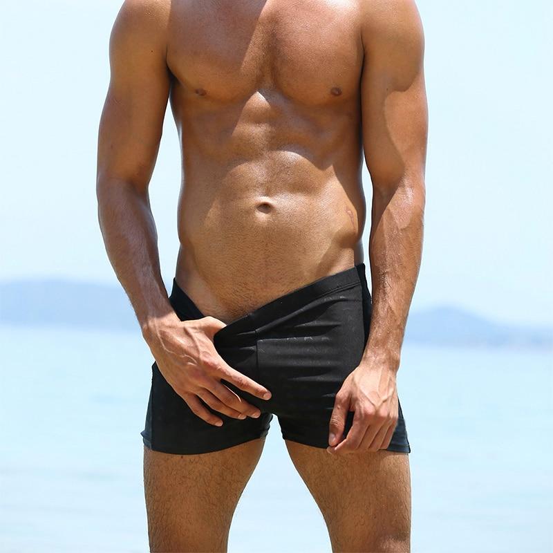75a15f5700 A317 neue solid black bademode männer sexy fitness übung schwimmen pool badeanzug  professionelle männer schwimmen stamm