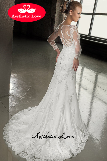Slimming trumpet style lace wedding dress is with small buttons. The ...
