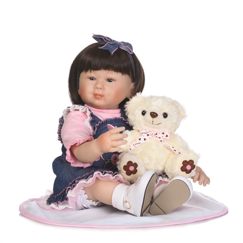 Real dolls for children gift 2255cm silicone baby dolls with bear plush doll fashion Denim skirt bebe alive reborn bonecasReal dolls for children gift 2255cm silicone baby dolls with bear plush doll fashion Denim skirt bebe alive reborn bonecas